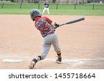 Youth Baseball Batter Swinging...