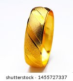 Gold Bracelets Isolated On...