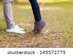 Teenage Couple Kissing Outdoor...
