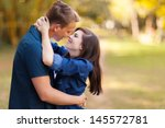 Loving Young Couple Kissing...