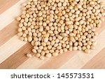 soy bean on wooden board   Shutterstock . vector #145573531