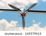 Small photo of Airplane propeller engine against blue sky closeup
