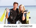 couple with scuba diving... | Shutterstock . vector #145580749