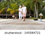 Senior Couple Walking On Woode...