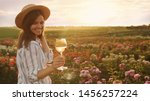 Woman With Glass Of Wine In...