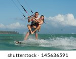 beautiful young pair riding... | Shutterstock . vector #145636591