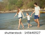 young family play on beach | Shutterstock . vector #145640527