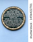 Small photo of Plymouth England July 2019. Sign on wall at Breton side, Plymouth commemorating the attack by Bretons from France in this area of the town in 1403 with great loss of life.