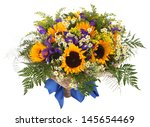 Flower Arrangement of sunflowers, daisies, ferns and goldenrod. Floral composition - stock photo