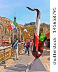 Small photo of DINANT, BELGIUM-APRIL 17: A view from the bridge over the Meuse river on April 17, 2013. The bridge is decorated with replicas of saxophones to honor Dinant's Adolphe Sax, inventor of the saxophone.