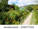 claude monet garden and house...   Shutterstock . vector #145677101