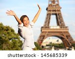Travel Paris Eiffel Tower woman. Happy tourist on travel holidays cheering joyful with arms raised up excited. Beautiful multiracial Asian Caucasian woman traveler in tourism concept. - stock photo