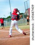 Young Baseball Kid Swinging Th...