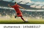 Soccer player kicks of the ball....