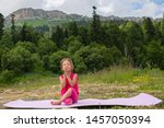 girl doing yoga in nature on a... | Shutterstock . vector #1457050394