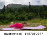 girl doing yoga in nature on a... | Shutterstock . vector #1457050397