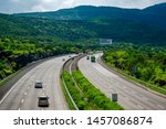 Small photo of Pune, India - July 21 2019: The Mumbai-Pune Expressway during the monsoon season near Pune India. Monsoon is the annual rainy season in India from June to September.
