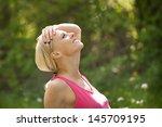 portrait of happy young blonde... | Shutterstock . vector #145709195