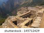 Machu Picchu ruins on the edge of the cliff overlooking Urubamba river valley. Cuzco, Peru. - stock photo