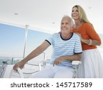 Smiling Middle Aged Couple At...