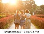 Three Girls Walking In The...