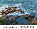 Waves Splashing Against Rocks...