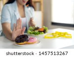 young girl rejecting junk food... | Shutterstock . vector #1457513267