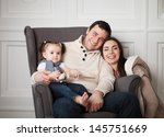happy smiling family with one... | Shutterstock . vector #145751669