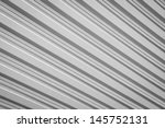 Texture of metal sheet corrugated background in black and white color - stock photo