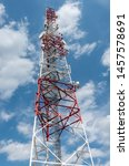 Telecommunication tower against cloudy blue sky