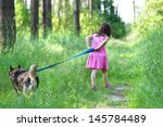 Little Girl With Dog Running O...