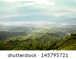 mountains under mist in the... | Shutterstock . vector #145795721