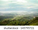 mountains under mist in the... | Shutterstock . vector #145795721