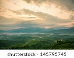 mountains under mist in the... | Shutterstock . vector #145795745