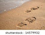 Footprints On The Sand Near Th...