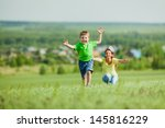 mom and son on the nature | Shutterstock . vector #145816229