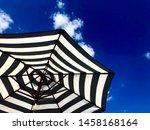 stripy umbrella against a deep...   Shutterstock . vector #1458168164
