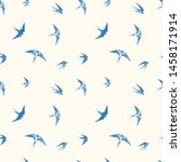 Stock vector seamless pattern with blue flying swallow birds on neutral light yellow background 1458171914