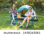 Stock photo people tourism and nature concept couple having fun on camping trip and play with cat 1458263081