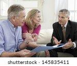mature couple sitting on sofa... | Shutterstock . vector #145835411