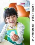 elementary school student doing ... | Shutterstock . vector #1458440054