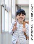 elementary school student... | Shutterstock . vector #1458529694