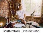 Woman In Headphones Recording...