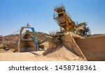 cranes and other industrial equipment of not working Arabic digging factory in Middle East desert region