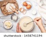 Woman Prepares Dough For...