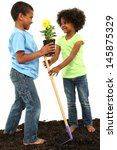 brother and sister planting... | Shutterstock . vector #145875329