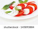 tomato and mozzarella with... | Shutterstock . vector #145893884