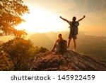 Two Hikers Enjoying Sunrise...