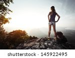 Young Lady Hiker With Backpack...