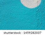 Small photo of Blue painted wall with white semicircle as background or texture